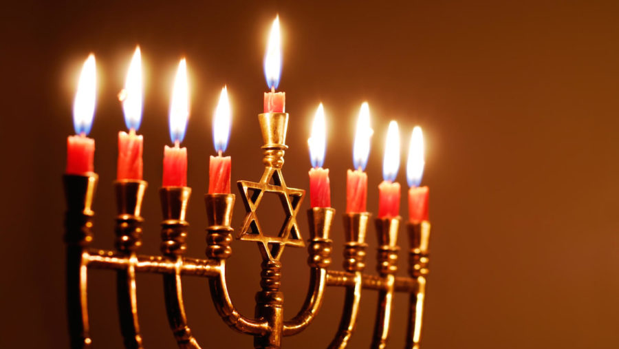Candles+lit+for+the+eighth+night+of+Hanukkah