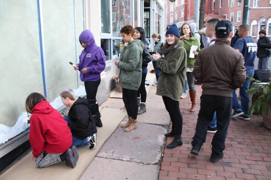 PCSD students paint windows in downtown Peekskill