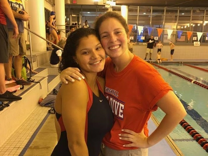 Mercury+staff+writer+Mya+Guardino+stands+with+Girls+Varsity+Swim+Coach+Nikki+Brady
